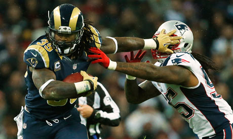 Steven Jackson attempts to fend off the New England Patriots middle linebacker Brandon Spikes